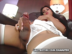 Ladyboy Amy stroking her chubby cock