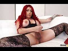 Red hot tranny strokes her thirsty cock
