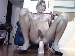 Gurl pushes a huge dildo up her shemale hole and rides it